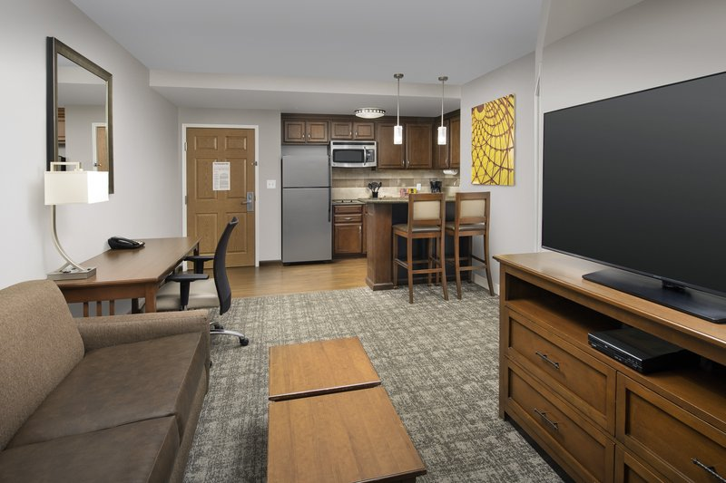 Staybridge Suites Columbia-Living space includes a queen sleeper sofa and a DVD player<br/>Image from Leonardo