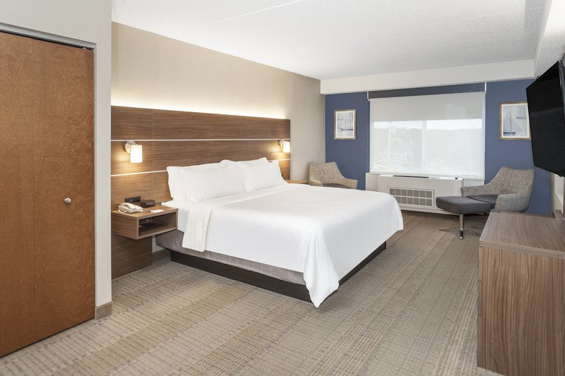 Holiday Inn Express & Suites Long Island-East End-King bed in bridal suite with natural light<br/>Image from Leonardo