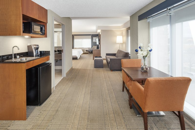 Holiday Inn Express & Suites Long Island-East End-Bridal Suite with natural light and living area<br/>Image from Leonardo