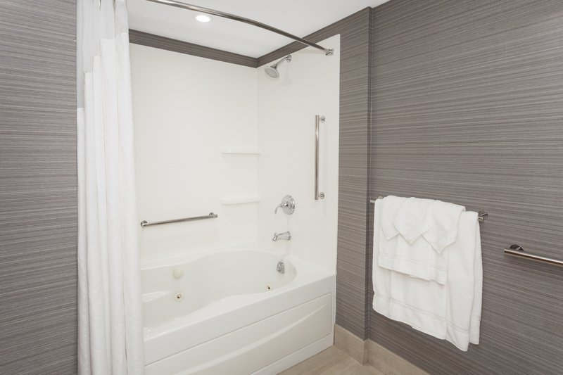 Holiday Inn Express & Suites Long Island-East End-Spacious guest bathroom with jacuzzi tub<br/>Image from Leonardo