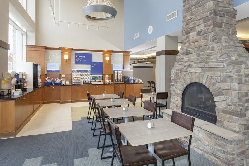 Holiday Inn Express & Suites Long Island-East End-Enjoy a peaceful guest lounge with fireplace<br/>Image from Leonardo