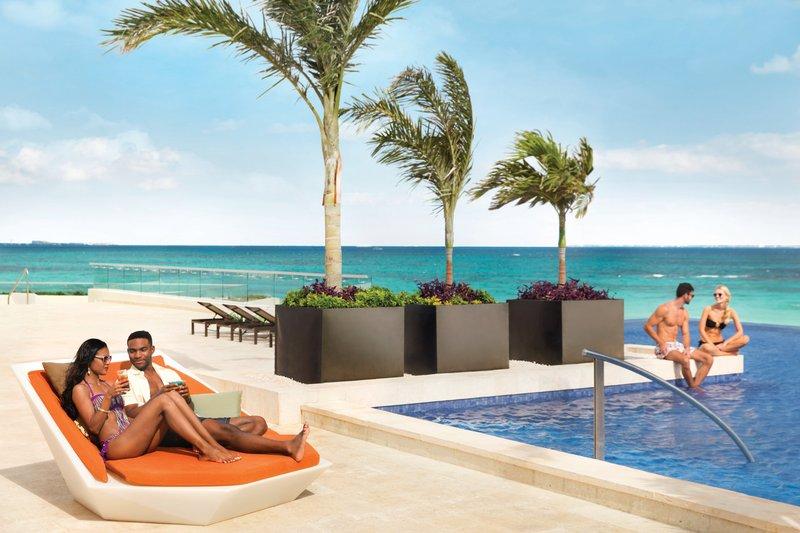 Hyatt Ziva Cancun  - Hyatt Ziva Cancun Pool Couple <br/>Image from Leonardo