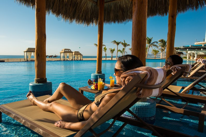 Hyatt Ziva Los Cabos - Couple At Infinity Pool <br/>Image from Leonardo