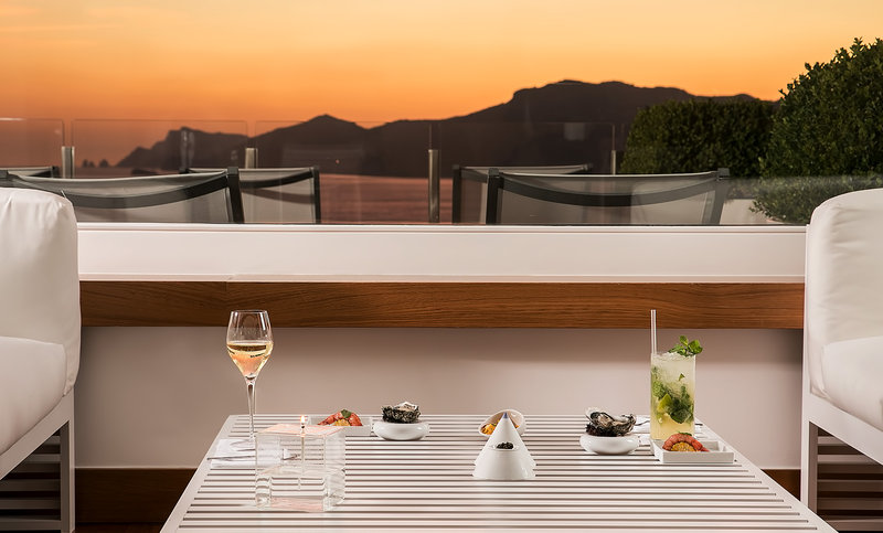Casa Angelina-Table Seascape Bar Indoor Sunset<br/>Image from Leonardo