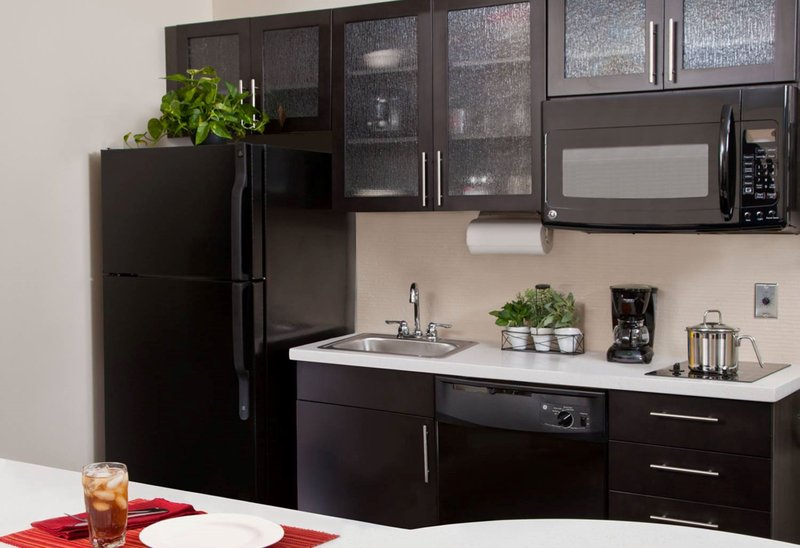 Candlewood Suites Boston-Burlington-One Bedroom Suite Kitchen with Fridge, Dishwasher, and Stove Top<br/>Image from Leonardo