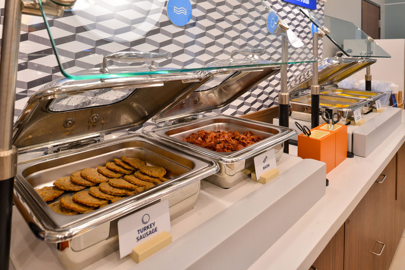 Holiday Inn Express & Suites Carlsbad Beach 4.4/5 | 506 Revi-You can't have breakfast without sausage and fresh cooked bacon!<br/>Image from Leonardo