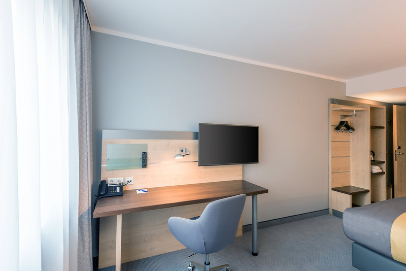 Holiday Inn Express Guetersloh-Desk with comfy chair and Multimedia<br/>Image from Leonardo