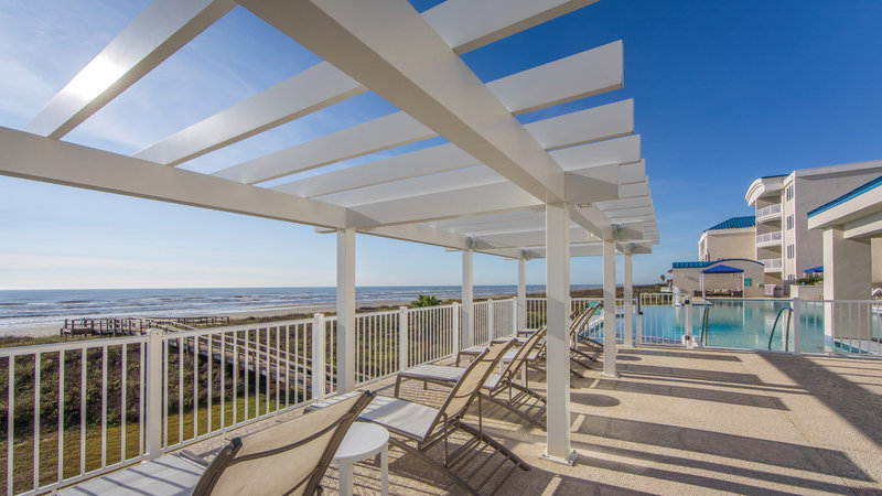 Holiday Inn Club Vacations Galveston Beach Resort-Outdoor sunchairs with a view of the beach.<br/>Image from Leonardo