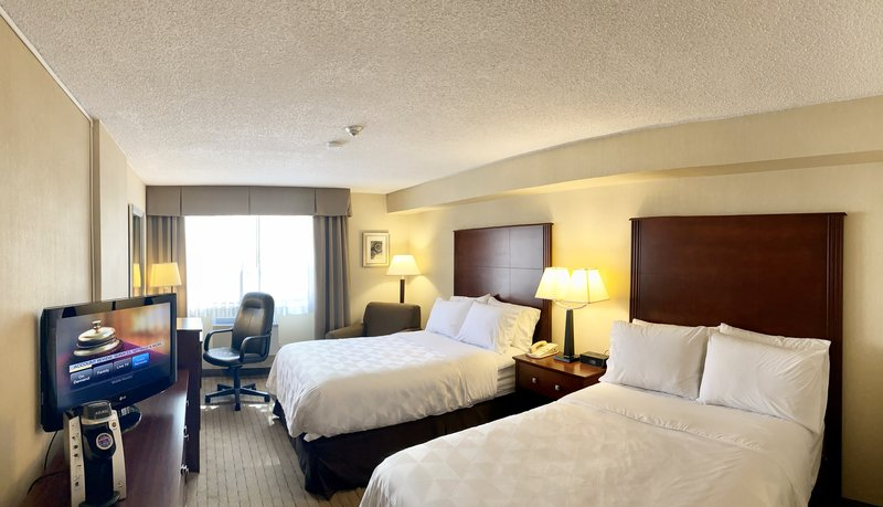 Holiday Inn Hotel & Suites Winnipeg-Downtown-Comfortable 2 queen beds with relaxing chair to enjoy the view.<br/>Image from Leonardo