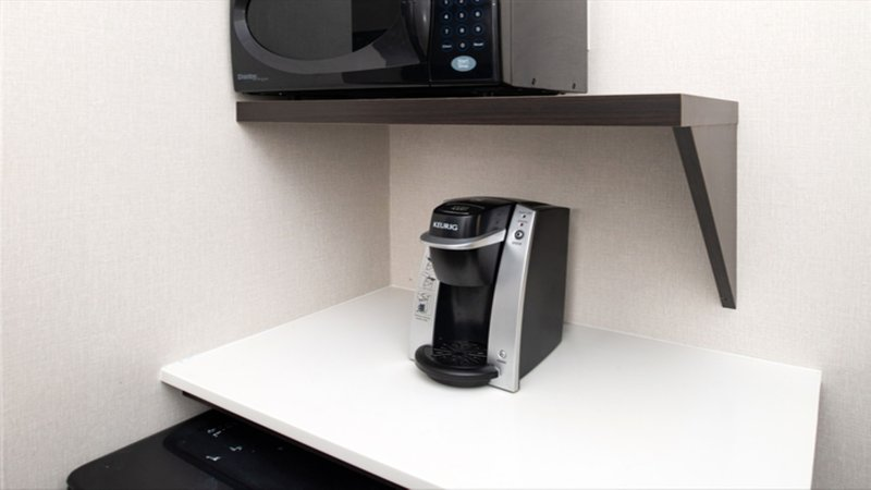 Holiday Inn Express Cincinnati West-King Feature Room With Keurig Coffe Machine<br/>Image from Leonardo