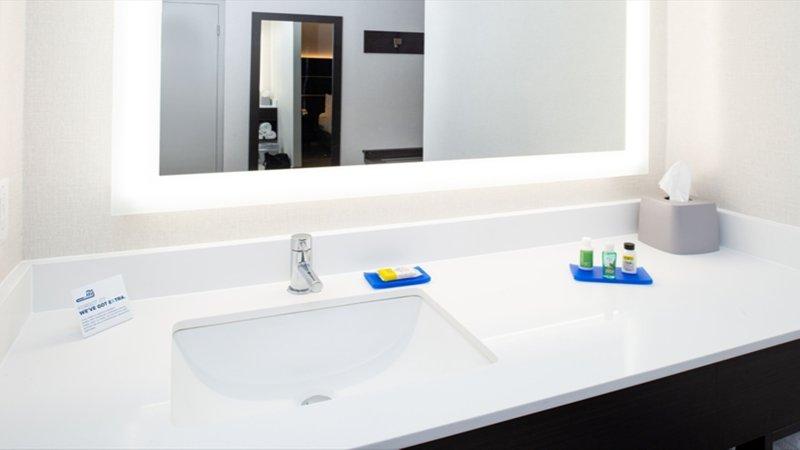 Holiday Inn Express Cincinnati West-1 King Bed Leisure Guest Bathroom<br/>Image from Leonardo