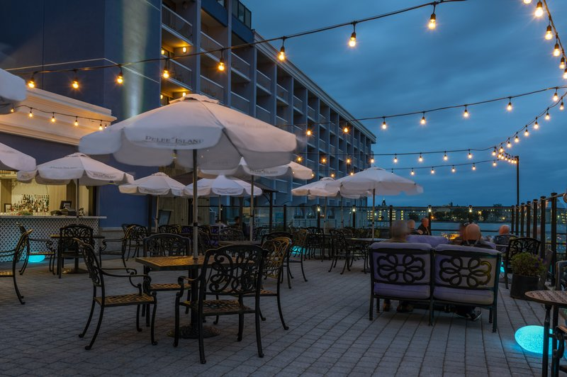 Holiday Inn Kingston - Waterfront-Cozy ambience at dusk Wharf & Feather Waterfront Patio Bar<br/>Image from Leonardo