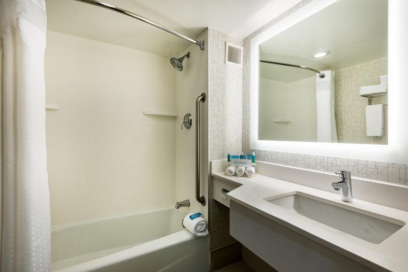 Holiday Inn Express Flint-Campus Area-Guest bathroom with tub<br/>Image from Leonardo