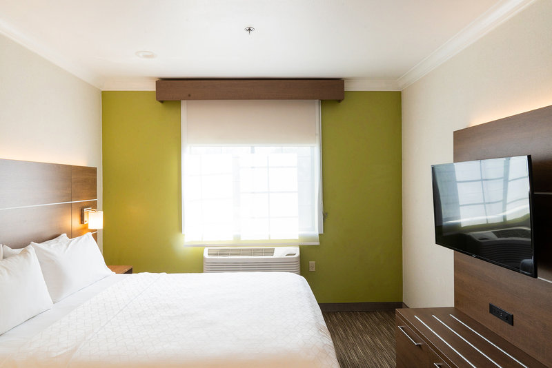 Holiday Inn Express & Suites Davis-University Area-ADA Mobility accessible King bedroom. <br/>Image from Leonardo