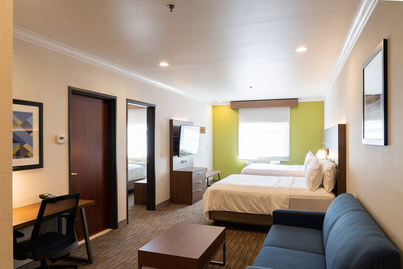 Holiday Inn Express & Suites Davis-University Area-Family Suite. 2 queen beds in living room + 1 king bed in bedroom.<br/>Image from Leonardo