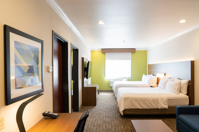 Holiday Inn Express & Suites Davis-University Area-Family Suite. Two queen beds in living room area. <br/>Image from Leonardo