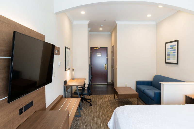 Holiday Inn Express & Suites Davis-University Area-Work station, sofa bed, coffee table in all Suites. <br/>Image from Leonardo