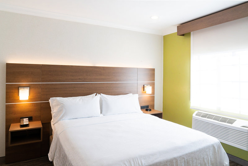 Holiday Inn Express & Suites Davis-University Area-Family Suite Private bedroom area. King bed. <br/>Image from Leonardo