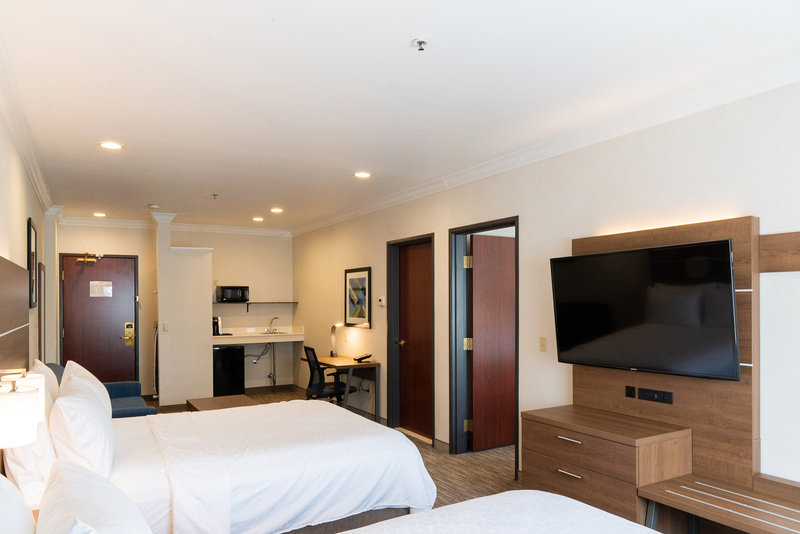 Holiday Inn Express & Suites Davis-University Area-Family Suite Living Room. Two queen beds and Sofa bed. <br/>Image from Leonardo