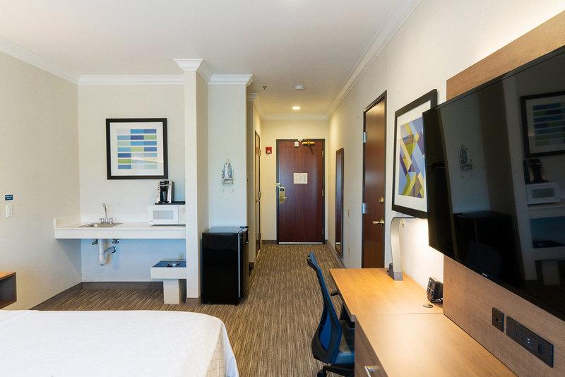 Holiday Inn Express & Suites Davis-University Area-ADA King Bedroom.  Mobility access room. <br/>Image from Leonardo