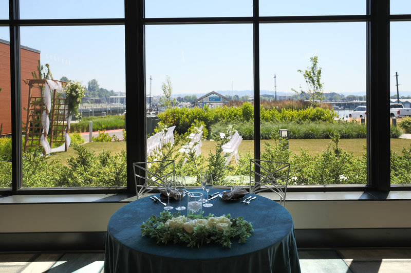 Hotel Indigo Seattle Everett Waterfront-Sweetheart Table with a beautiful view.<br/>Image from Leonardo
